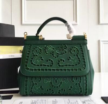 2016 European spring fashion leather handbags discount sale selling hollow embroidery(China (Mainland))