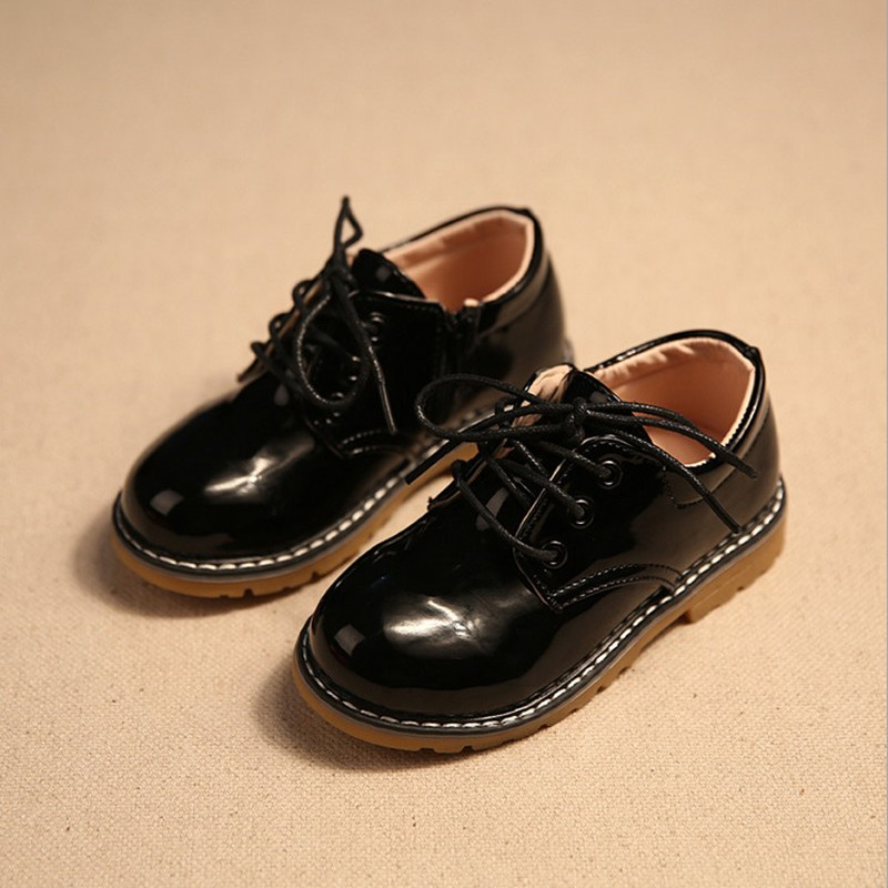 New children shoes bright skin leather shoes the bulk of non-slip boots children boys and girls leather shoes casual shoes(China (Mainland))