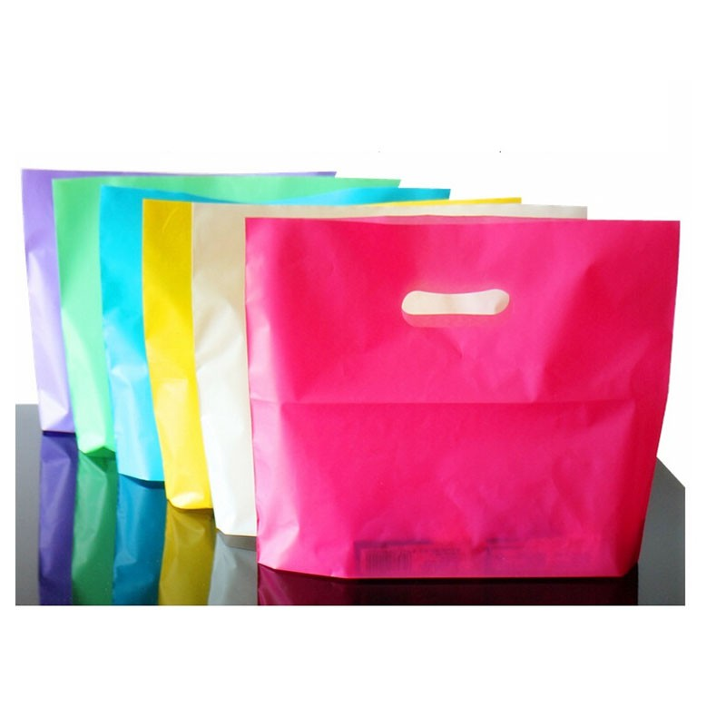 Colorful Plastic Shopping Bags with Handle Pink Boutique Clothes Gift Packaging Bag Plastic Shopping Bags Handles(China (Mainland))
