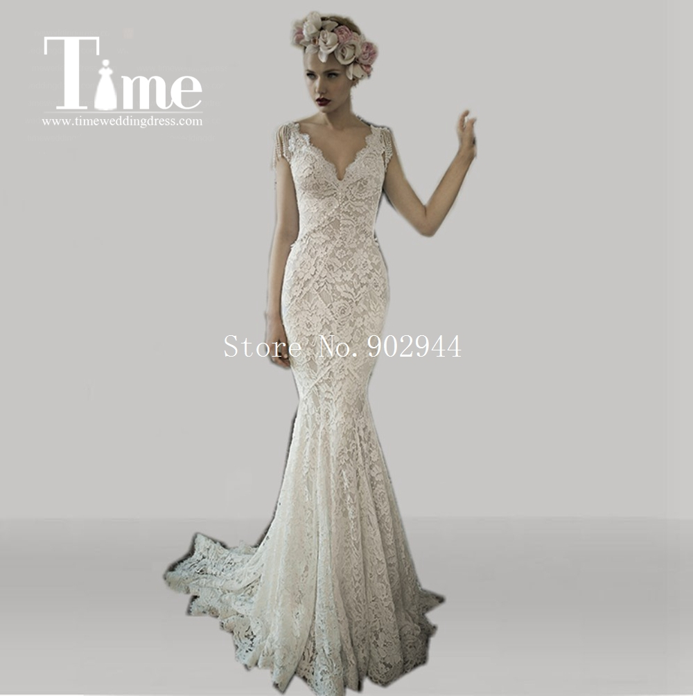 Backless lace wedding dresses 2015 pluning v neck cap for Lace wedding dress with pearls