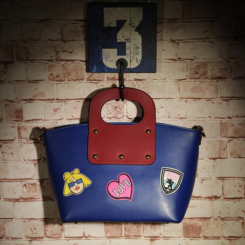 Summer fashion tide models cowhide leather handbags hand basket more cartoon logo handbag female shoulder portable manual bags(China (Mainland))