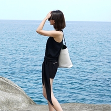 [TWOTWINSTYLE] 2016 summer irregular clipping design knot tie sleeveless chiffon vest female loose tank women tops(China (Mainland))