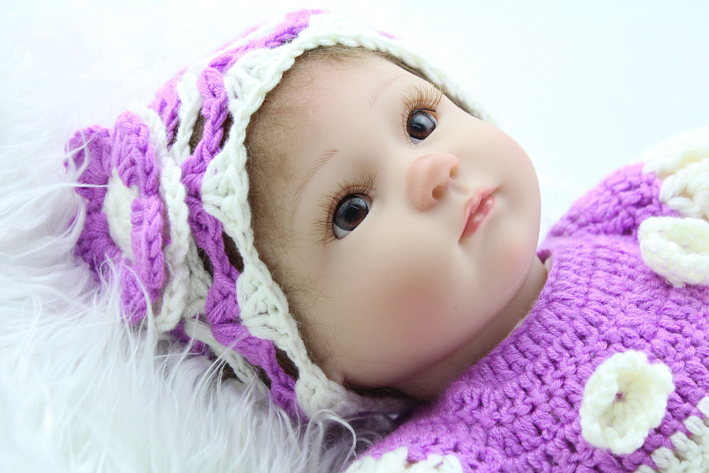 Christmas present purple dress eyes open from reliable dolls suppliers