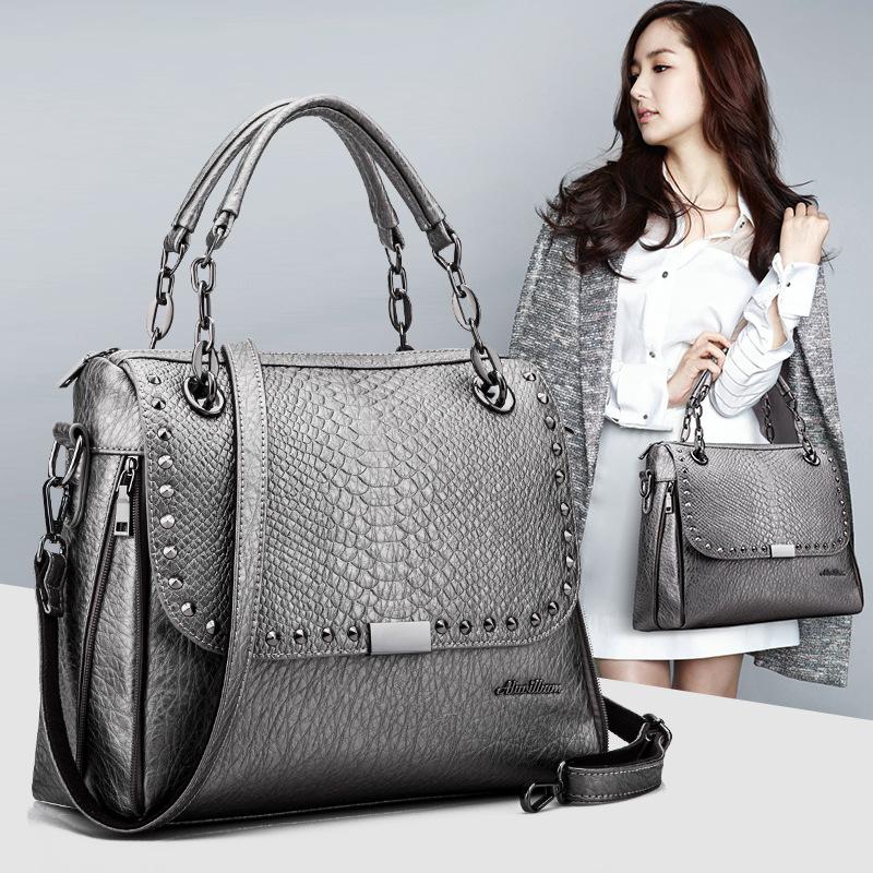 2016 New Genuine Leather Bag Famous Brand Women Messenger Bags Shoulder Bag Women Leather Handbags Sac A Main Vintage Rivet Tote(China (Mainland))