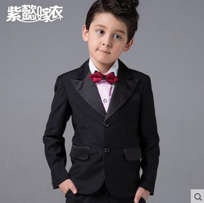 Black on black suit with bow tie