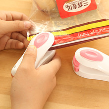 A09-2-05 portable plastic bag sealing machine for household use hand heat seal machine plastic sealing clip without battery(China (Mainland))