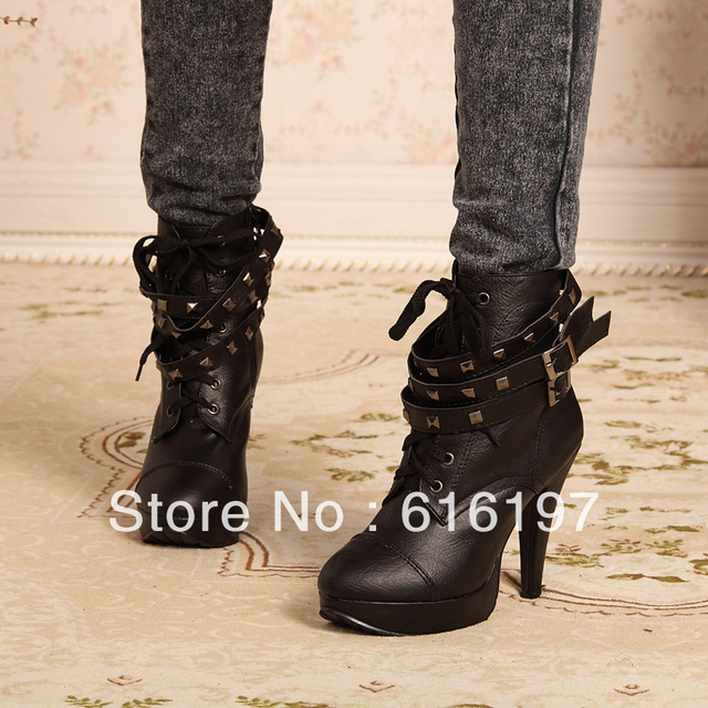 Free shipping women's snow boot Autumn and winter motorcycle boots high-heeled shoes black  rivets boots