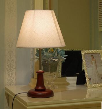 The bedroom nightstand warm light lamp Linen fabric