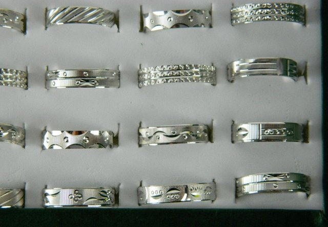 Free shipping US$42.11 for 100pcs mixed style mixed size plated 925silver ring sculpture figure ring