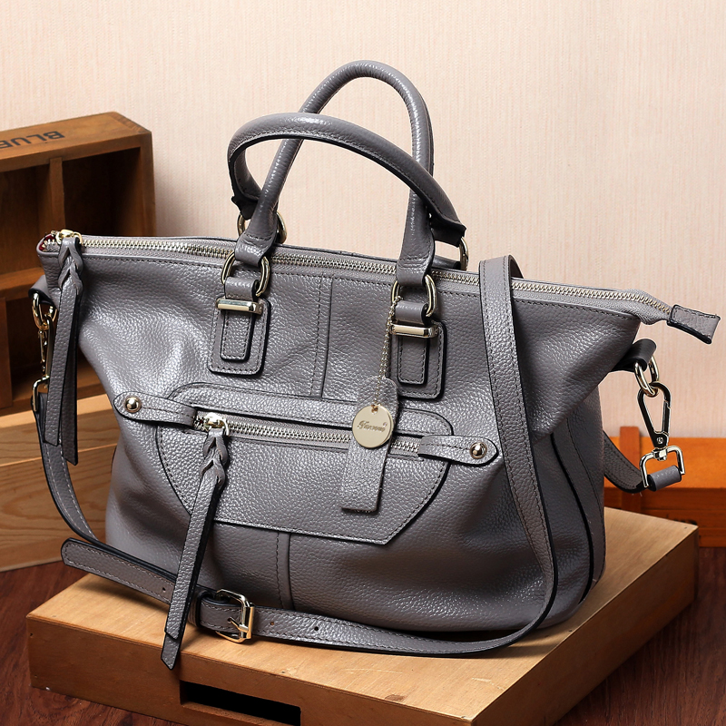 The new  fashion rive soft cattlehide real-leather handbag  casual swagger bag Messenger large bag shoulder Bags  free shoping <br><br>Aliexpress