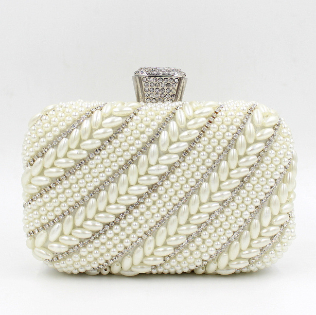 The supply of 2016 new European pearl diamond Yanbao high-grade ceramic hand bag dress evening bag(China (Mainland))