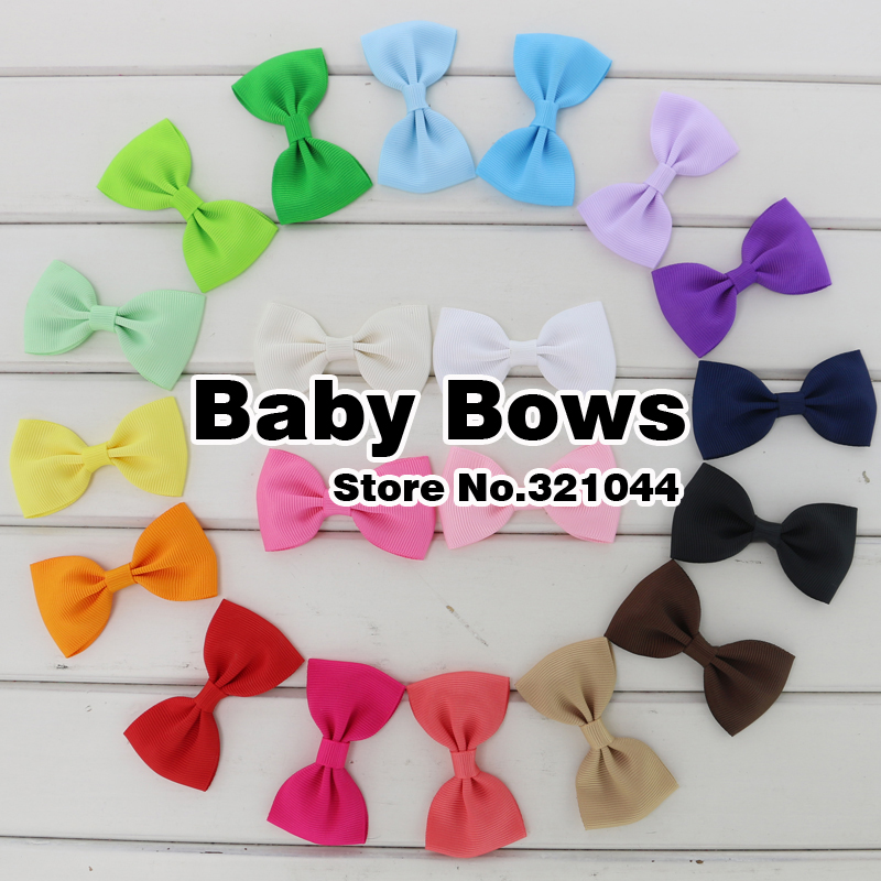 200pcs/lot Baby Girls Boutique Solid Grosgrain Hair Ribbon Bows Hairpins Bows Knot Hair Barrettes Bows For Babies Toddlers(China (Mainland))