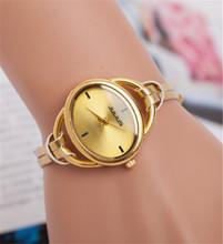 Nuevas adquisiciones! 2015 moda elegante elegante Oval Dial PU correa de cuero de oro mujeres reloj de cuarzo