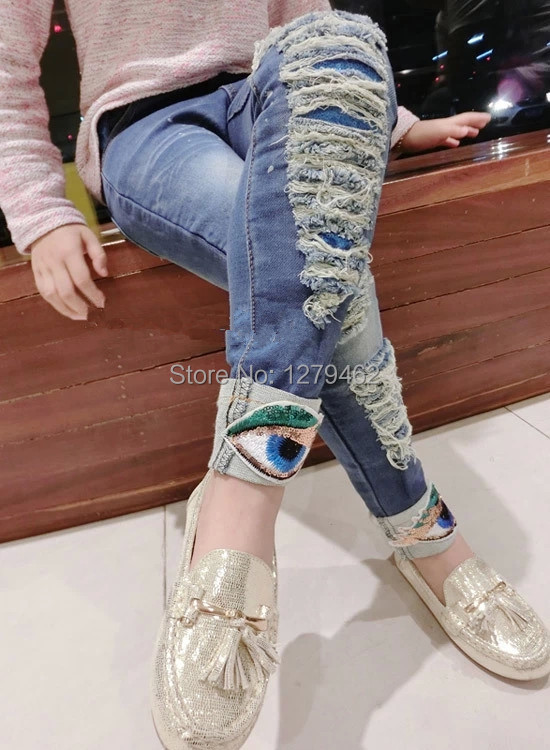 Ripped Jeans Girl - Xtellar Jeans