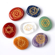 Free shipping 7 piece Engraved Chakra Stone Palm Stone Crystal Reiki Healing With Pouch EN0001SY(China (Mainland))