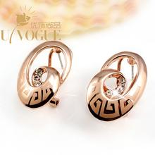 New Design 18K Rose Gold/Platinum Silver Plated UVOGUE Brand Jewelry Fashion Vintage RhineStone Heart Laser Women Stud Earrings(China (Mainland))