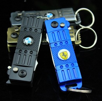 Wholesale 10PCS / lots Outdoor multifunctional spring automatic knife lighter keychain emblem switch lockable windproof lighters