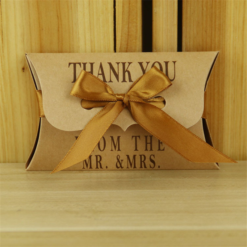 50pcs/lot Wedding Gift Boxes Kraft Pillow Shape Wedding Favor Gift Box Party Candy Box with Golden Ribbon Festive Party Supplies(China (Mainland))
