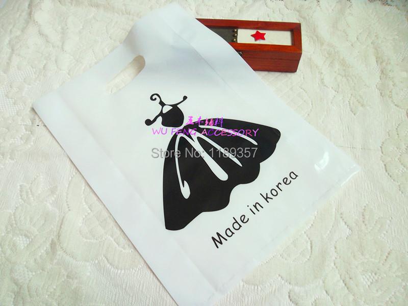 In stock fashion packing bag (40pcs/lot) women clothing garment bag ,plastic packing bag ,dress cute tote gift bag dp675(China (Mainland))