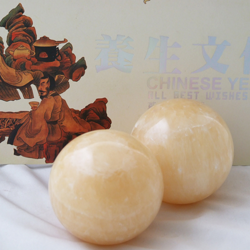 Baoding stone balls, jade yellow 55mm.Palm exercise stress relief balls.Health care products.Marble baoding balls.Red paper box.(China (Mainland))