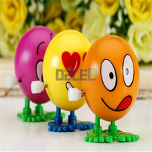 2016 New Cool On The Chain Clockwork Doll Expression Face Bouncing Ball Children's Educational Toys Gifts Wind up Toys