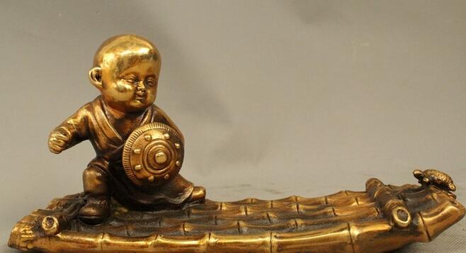 "10"" Old Tibetan Buddhism Bronze Gild Boy monk Bonze Rowing Buddha Statue wholesale Bronze Arts outlets(China (Mainland))"