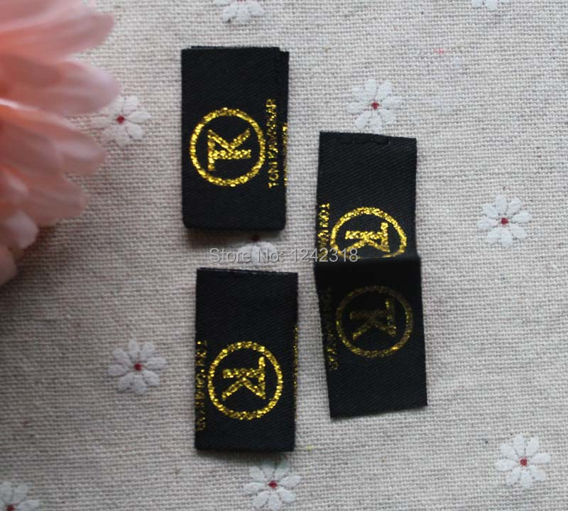 custom toy/pillow/baby black background with shiny gold brand name logo woven loop fold/center fold clothing woven main labels(China (Mainland))