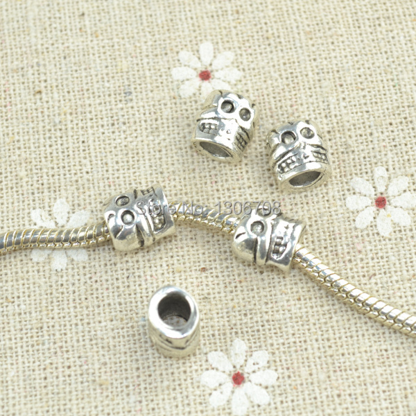 70pcs/lots Metal antique tibetan silver charms skull heads beads for European bracelets making diy jewelry findings z42404(China (Mainland))