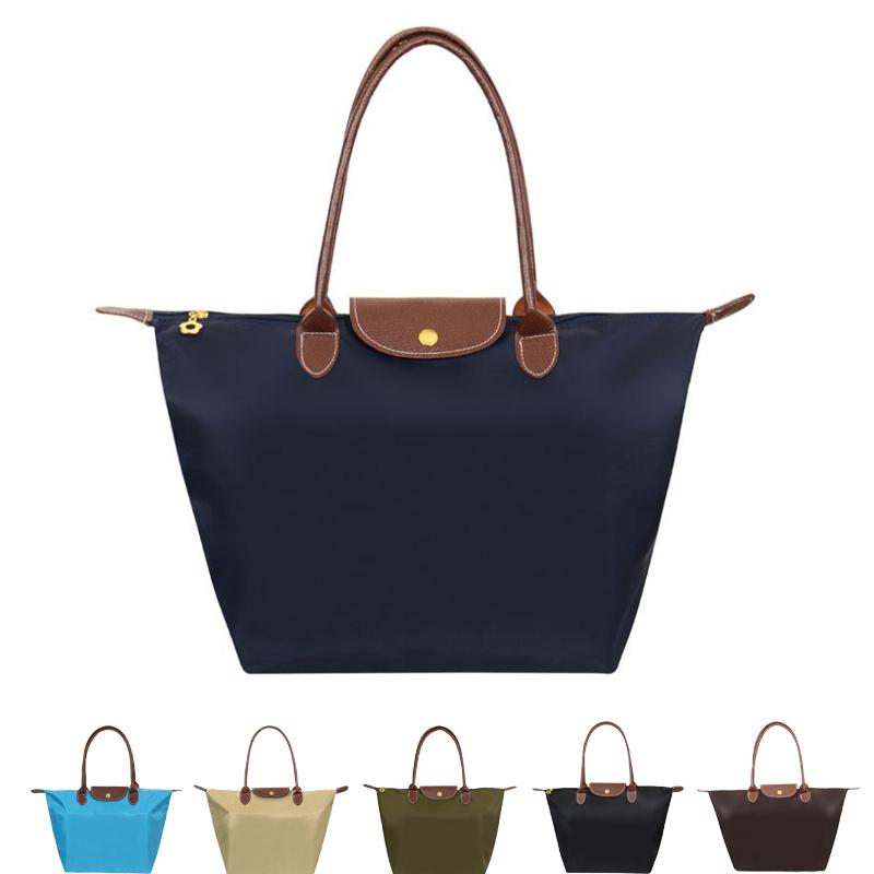 High quality nylon dumplings package tote bag women bag folding handbags famous brand beach bag bolsa feminina(China (Mainland))