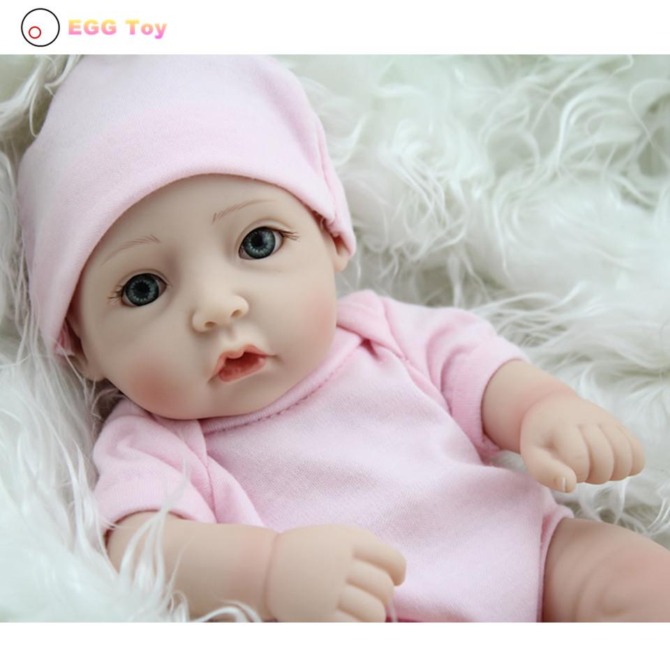 Фотография Pink Full body Silicone Reborn Baby Doll Toys 28cm blue eye Lifelike Baby Girls Doll Play House toy Reborn Doll Educational toys