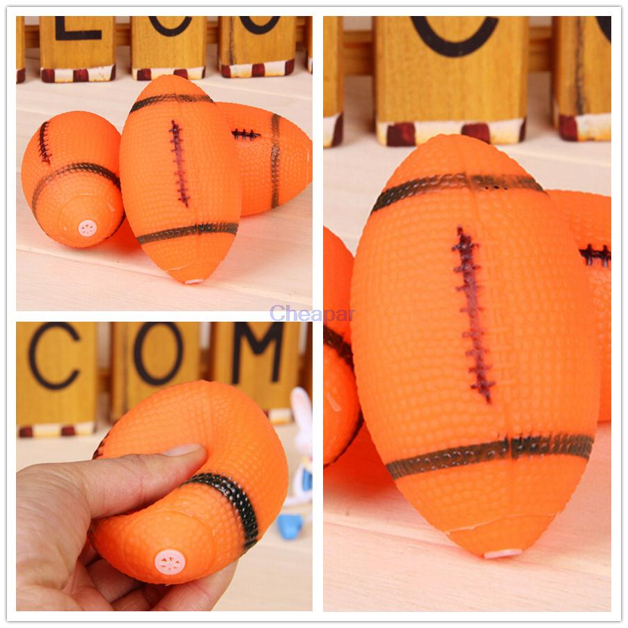 Dog Squeaky Toy For Pet Dog Chew Toy Small Rubber Squeaky Rugby Ball Orange(China (Mainland))