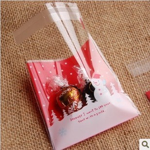100pcs/lot 11*10+3cm Merry Christmas Snowman Plastic Self Adhesive Sealing Cookie Bags Packing Cake Packaging Free Shipping(China (Mainland))