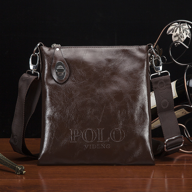 2015 sell like hot cakes Fashion man shoulder bag Leather Men Messenger Bag Leisure Bag Briefcase Two colors are optional(China (Mainland))