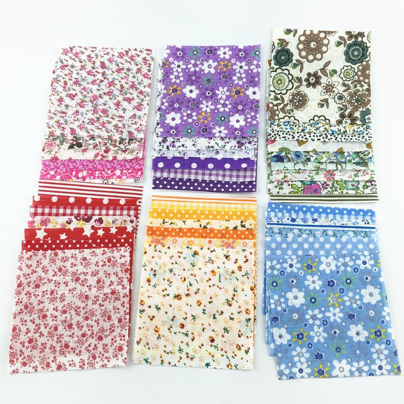 30 pçs/lote 10 cm x 10 cm cor aleatória pacotes charme tecido Patchwork tecidos de algodão acolchoado tecido de nenhum projeto de repetição(China (Mainland))