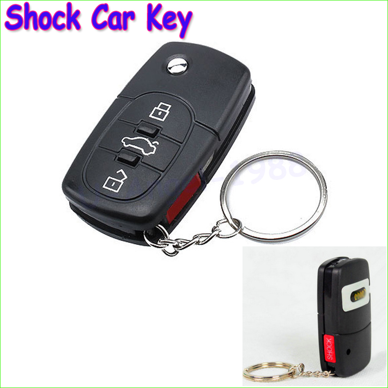 Wholesale 1pcs ONLY Electric Shock Gag Joke Prank Car Key Remote Control Fun with LED Light Electronic Toys Drop freeship(China (Mainland))