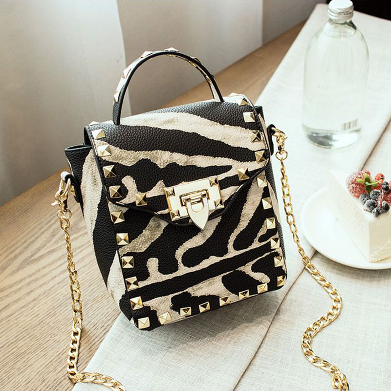 Women rivet chain packet European and American fashion of the small square package zebra handbags mini shoulder messenger bag(China (Mainland))