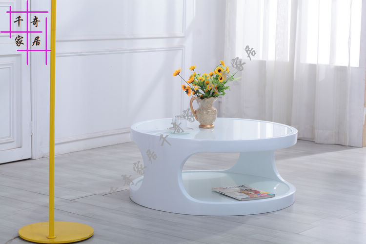 Features stylish minimalist coffee table modern creative personality super white tempered glass coffee table round coffee table(China (Mainland))