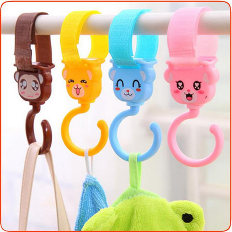 Urijk Cartoon Pram Hooks 360 Rotating Stroller Headrest Hanger Holder Hooks Cute Baby Carriage Pushchair Hanger Hanging Hooks(China (Mainland))