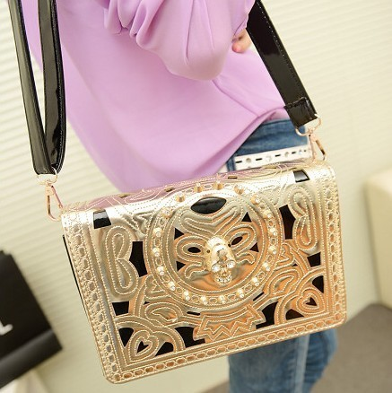 Free shipping wholesale retail 2013 new hollow carved skull metal chain single shoulder hand bag fashion women package 252