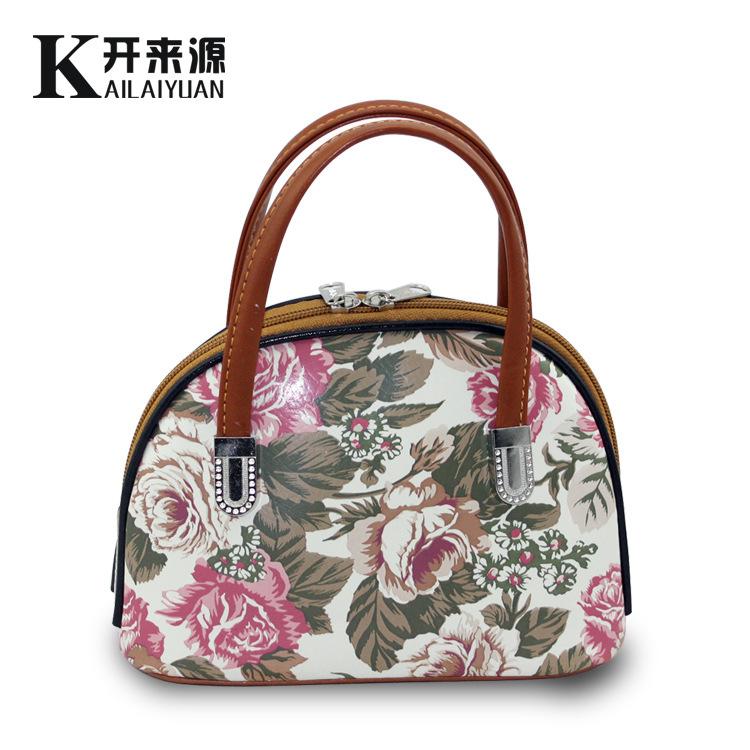 100% Genuine leather Women handbags 2016 bag purse bag carrying a small bag Mini key mobile phone manufacturers wholesale sales(China (Mainland))