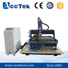 China good working performance small wood cutting cnc router 6090 with water tank(China (Mainland))
