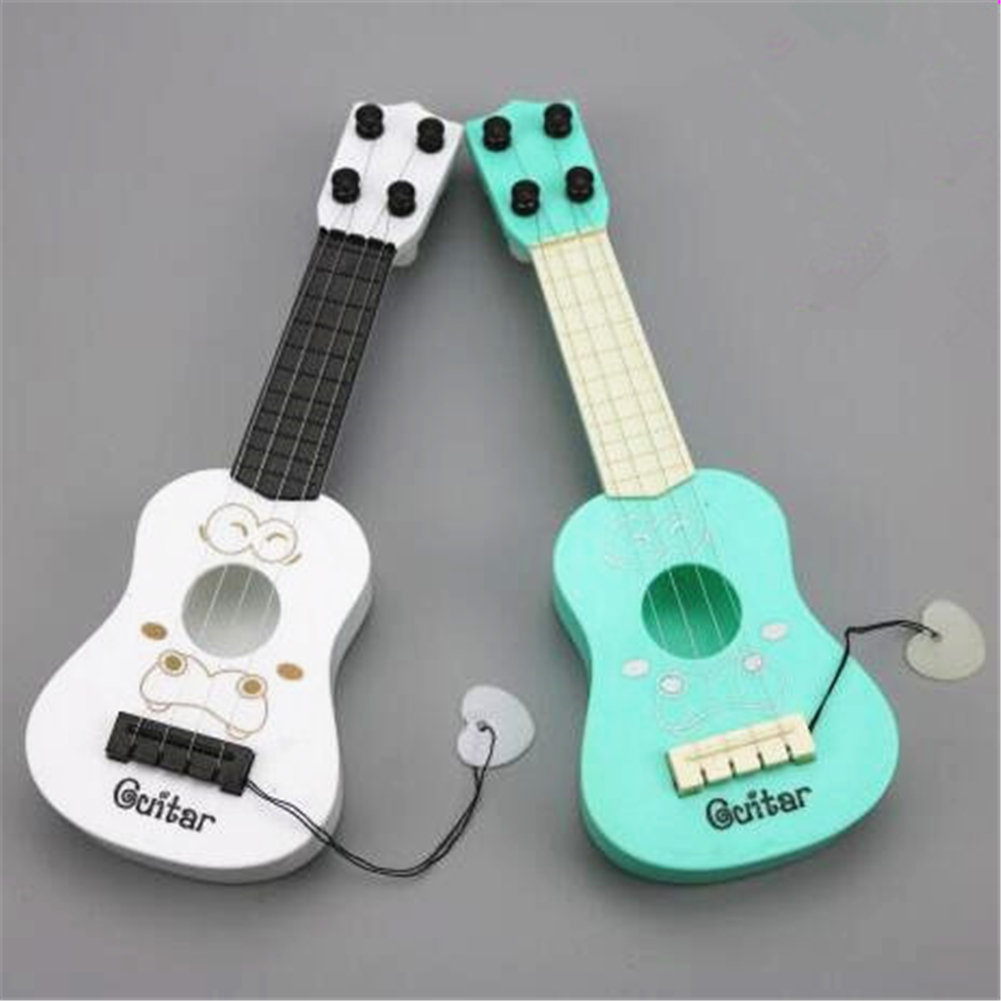 [PCMOS] Childhood String Types Mini Guitar Early Eductional Music Instrument Toy Doll No Box Free Shipping T1073(China (Mainland))