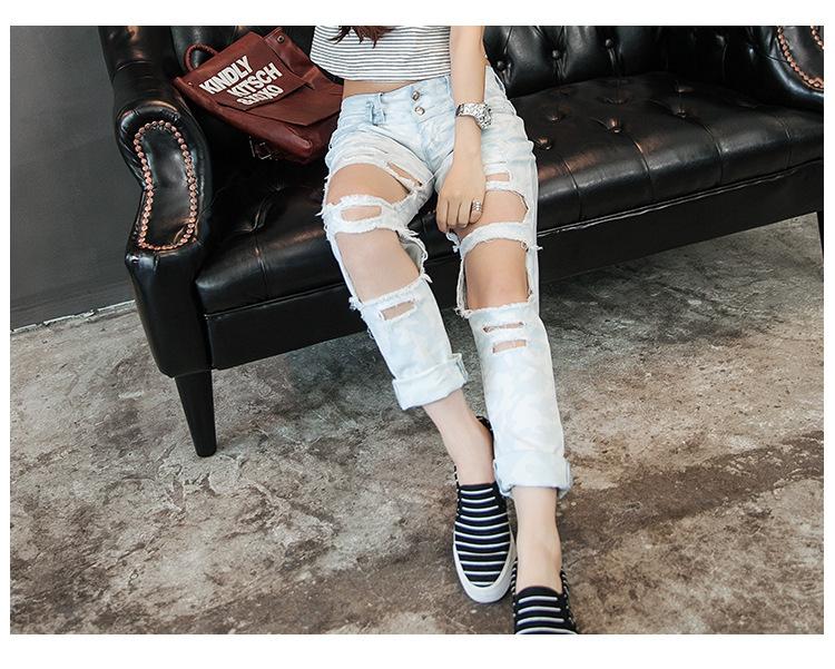 Скидки на 2015 Мода рваные джинсы для Женщин Осень Новый Стиль Дамы Джинсы Свободные прямые большая дыра джинсовые брюки femininas