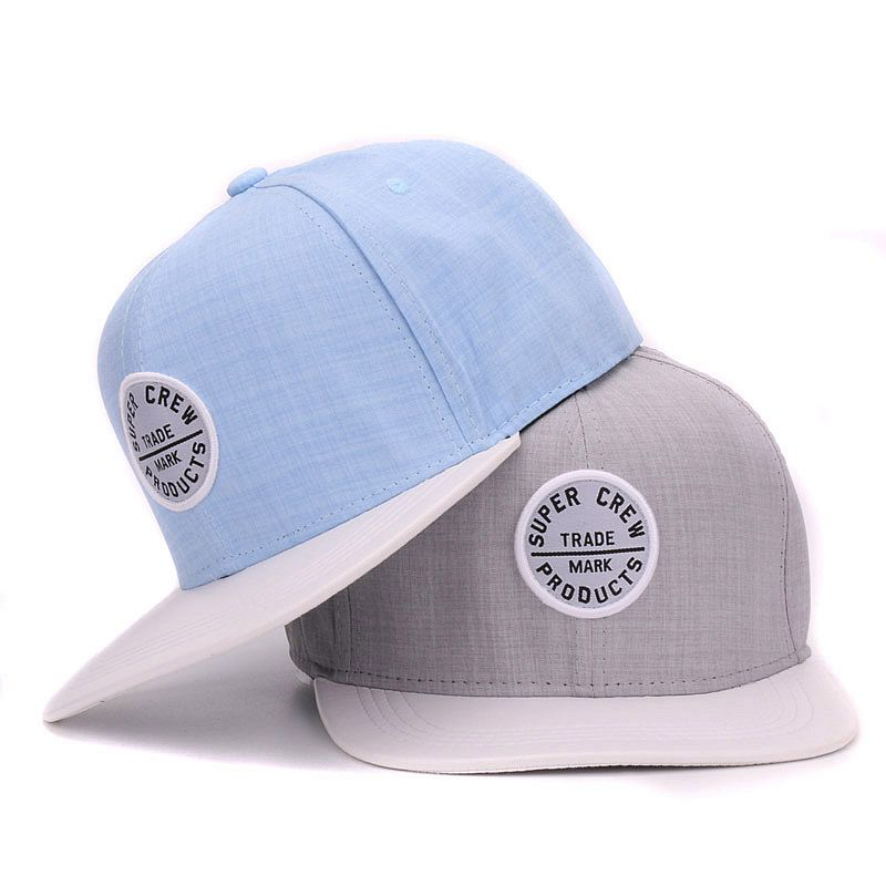 Good quality simple two tone snapback cap cotton flat solf pu brim baseball cap with small round embroidery patch(China (Mainland))