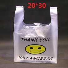 20*30cm 100pcs High Quality HDPE Supermarket Yellow Lovely Smile White Vest Plastic Carrier Shopping Hand Bag Packaging Bags Hot(China (Mainland))
