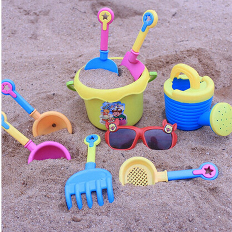 Funny Beach Sand Play Water Toy 9pcs Kids Seaside Excavating Tools With Spade Shovel Sunglasses Outdoor Hourglass Paddle Set(China (Mainland))