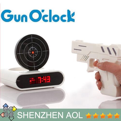 Meilleures ventes! Nouveautés très amusant alarme Laser Gun Target nouveauté O'clock Gun Clock de noël de cadeau d'anniversaire 2 pcs/lote(China (Mainland))