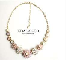 Early summer small pure and fresh, the moonlight the cat's eye gem flower necklace Collarbone chain Han edition of pop(China (Mainland))