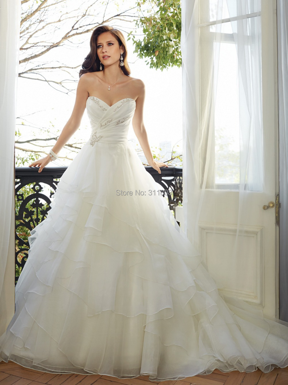 Strapless bridal gowns organza ruffles sweet heart neck a for Sexy designer wedding dresses