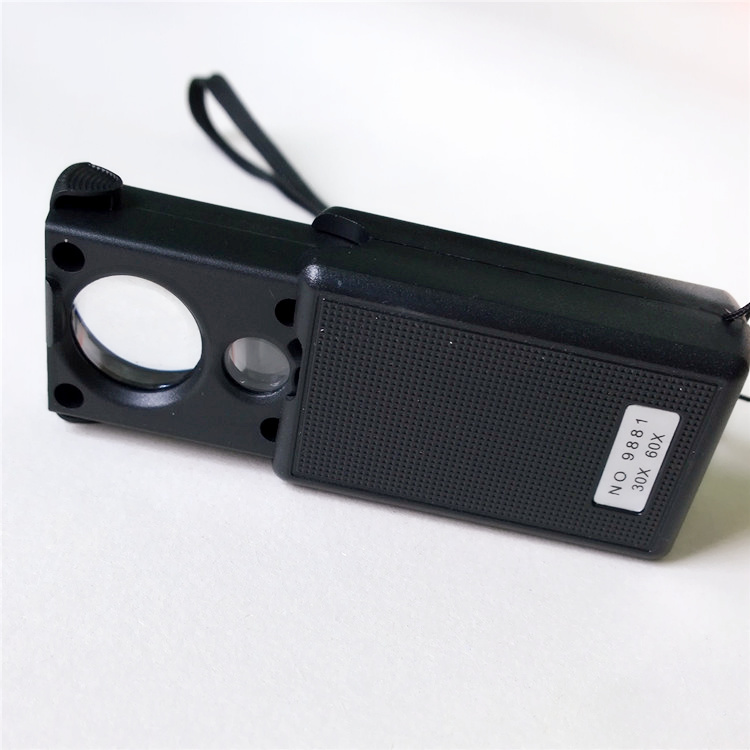 30 X/60 X the size of a magnifying glass white uv dual light, LED magnifying lens Special tool identification/detection product(China (Mainland))